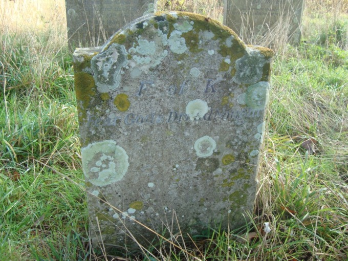 The footstone of Fisher's grave: 'F of K Fear God and Dread Nought'